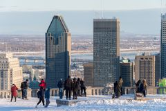 Tourists looking at Montreal Skyline in winter stock photo