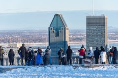 Tourists looking at Montreal Skyline in winter royalty free stock images