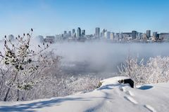 Montreal Skyline and St. Lawrence River in winter stock image
