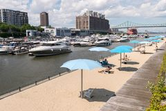 Clock Tower Beach in the Old Port of Montreal stock photography