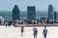 People looking at Montreal Skyline from Mont Royal lookout stock images