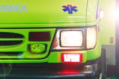 Montreal, Canada – March 25, 2018: Ambulance car in the hospital park. Canadian ambulance car with lights and siren in action stock photography