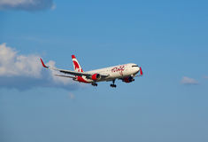 Air Canada Rouge landing plane. Royalty Free Stock Photo
