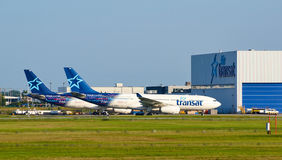 Air Transat airplanes and garage. MONTREAL, CANADA - AUGUST 28, 2017 : Air Transat planes. Air Transat is a Canadian leisure airline based in Montreal Quebec royalty free stock photography