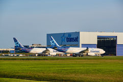 Air Transat airplanes and garage. MONTREAL, CANADA - AUGUST 28, 2017 : Air Transat planes and garage. Air Transat is a Canadian leisure airline based in stock photography