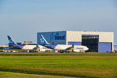 Air Transat airplanes and garage. MONTREAL, CANADA - AUGUST 28, 2017 : Air Transat planes and garage. Air Transat is a Canadian leisure airline based in royalty free stock photo