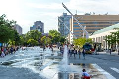 Central Place des Arts Square with fountains in Montreal downtown, Canada. Montreal, Canada - August 5, 2018: Central Place des Arts Square with fountains in stock photo