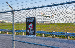 No drones zone sign and airplane. MONTREAL, CANADA - AUGUST 28, 2017 : No drones zone sign and airplane at Montreal YUL airport stock photography
