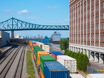 Montreal, Canada - august 19, 2018: View of old port area with train and ship in downtown of Montreal. stock photography