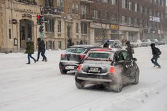Traffic on Saint Denis Street during first snow storm of the sea stock images