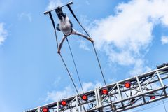 Trapeze artist performing outside stock images