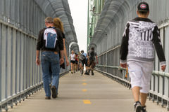 Montreal, Canada - June 07, 2015:People walking at bicycle road Stock Photos