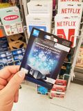 A hand holding American Express gift card. MONTREAL, CANADA - MARCH 31, 2018 : A hand holding American Express gift card. The American Express Company, also Royalty Free Stock Photo