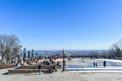 People and Montreal Skyline. Montreal, Canada - March 20, 2016: People and Montreal Skyline from Kondiaronk Belvedere / Mont-Royal in Winter royalty free stock photos