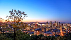 Montreal, CANADA - 21 May 2018. Montreal sunrise view from Belvedere with summer colorful leaves. Beautiful panorama of Montreal royalty free stock images