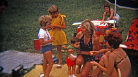 MONTREAL, CANADA 1975: Mod colorful family picnic from French Canadians outside of Montreal.