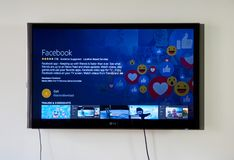 Facebook app and login page on LG TV. MONTREAL, CANADA - NOVEMBER 15, 2017: Facebook app and on LG TV. Facebook is an American for-profit corporation and an Royalty Free Stock Image