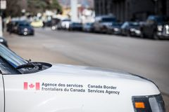 Canada Border Services Agency vehicle with its loog in downtown montreal. Also known as CBSA, the agency enforces border control. MONTREAL, CANADA - NOVEMBER 7 royalty free stock images