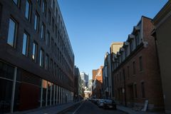 Business skyscrapers in the dowtown of Montreal, seen from a nearby street of the main city of Quebec. MONTREAL, CANADA - NOVEMBER 4, 2018: Picture of royalty free stock photography
