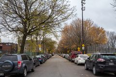 Typical north American residential street in autumn in Cote des Neiges Montreal, Quebec, during an autumn afternoon. MONTREAL, CANADA - NOVEMBER 9, 2018 stock photography