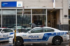 Two Montreal Police Service SPVM cars standing in front of a local police station. The SPVM is the police of Montreal, Quebec. MONTREAL, CANADA - NOVEMBER 5 royalty free stock image