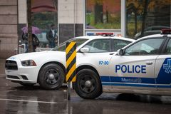 Two Montreal Police Service SPVM cars standing in front of a local police station. royalty free stock photos