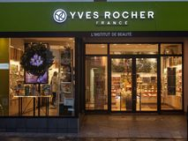 Yves Rocher logo in front of their main store for Montreal, Quebec. Yves Rocher is a French cosmetics and beauty brand. MONTREAL, CANADA - NOVEMBER 3, 2018: Yves stock images