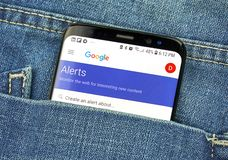 Google Alerts on a phone screen in a pocket. MONTREAL, CANADA - OCTOBER 4, 2018: Google Alerts on s8 screen. Google Alerts is a content change notification royalty free stock photo
