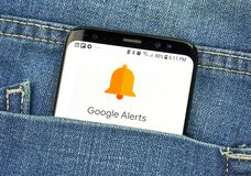Google Alerts on a phone screen in a pocket. MONTREAL, CANADA - OCTOBER 4, 2018: Google Alerts on s8 screen. Google Alerts is a content change notification stock photography