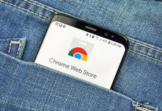 Chrome Web Store on a phone screen in a pocket stock image