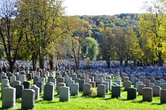 Graves in Notre-Dame-des-Neiges Cemetery. MONTREAL CANADA OCTOBER 11 2015: Graves in Notre-Dame-des-Neiges Cemetery with colorful autumn trees. Is the largest royalty free stock images