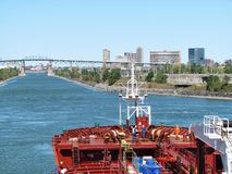 Big red tanker ships oil passing through St. Lawrence Seaway in Montreal, Canada stock photo