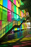 Windows reflection at congres center in Montreal. MONTREAL, CANADA - September 14, 2017: Colourful glass panels and stairs in Palais des congres de Montreal Royalty Free Stock Image