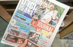 A hand holding Le Journal de Montreal newspaper. royalty free stock images