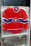 Montreal Canadians jersey. MONTREAL CANADA JANUARY 24: Montreal Canadians jersey in an ice block in front the Molson center of Montreal Canadians for the 57e All Royalty Free Stock Images