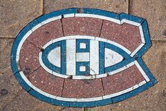 Montreal Canadiens Ice Hockey team emblem. Montreal, Canada - 21st August 2014: The emblem for the Montreal Canadiens Ice Hockey team set into the pavement Stock Images