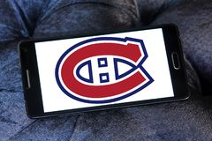 Montreal Canadiens ice hockey team logo. Logo of Montreal Canadiens ice hockey team on samsung mobile. Montreal Canadiens are a professional ice hockey team Royalty Free Stock Photography