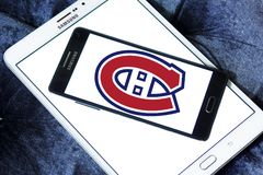 Montreal Canadiens ice hockey team logo. Logo of Montreal Canadiens ice hockey team on samsung mobile. Montreal Canadiens are a professional ice hockey team Royalty Free Stock Photo