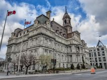Montreal City Hall. The five-story Montreal City Hall French: Hôtel de Ville de Montréal is the work of architects Henri-Maurice Perrault and Alexander stock images