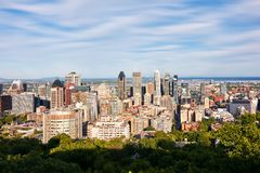 Montreal city skyline view from Mount Royal on a sunny summer afternoon in Quebec, Canada. Montreal, Canada - June, 2018: Montreal city skyline view from Mount stock images