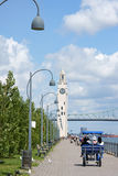 Montreal Clock Tower and Jacques Cartier Bridge. Montreal, Canada - July 26, 2008: Montreal clock tower located at the entrance of the old port of Montreal (Quai Stock Photography