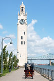 Montreal Clock Tower and Jacques Cartier Bridge, Canada. Montreal, Canada - July 26, 2008: Montreal clock tower located at the entrance of the old port of Stock Photography