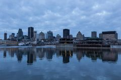 Montreal downtown skyline reflected in the St. Lawrence river stock photography