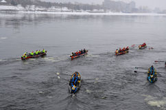 Montreal Ice Canoe Challenge. MONTREAL - FEBRUARY 23: Unidentified participants at the Montreal Ice Canoe Challenge on St. Lawrence River on February 23, 2013 in Stock Photography