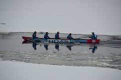 Montreal Ice Canoe Challenge. MONTREAL - FEBRUARY 23: Unidentified participants at the Montreal Ice Canoe Challenge on St. Lawrence River on February 23, 2013 in Royalty Free Stock Images