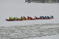 Montreal Ice Canoe Challenge. MONTREAL - FEBRUARY 23: Unidentified participants at the Montreal Ice Canoe Challenge on St. Lawrence River on February 23, 2013 in Stock Photo
