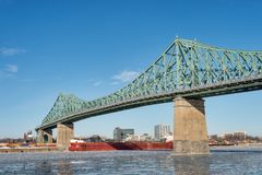 Montreal Jacques Cartier Bridge in winter 2018. Montreal Jacques Cartier Bridge in winter, with chunks of ice floating on the Saint-lawrence 2018 stock photo