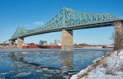 Montreal Jacques Cartier Bridge in winter 2018. Montreal Jacques Cartier Bridge in winter, with chunks of ice floating on the Saint-lawrence 2018 royalty free stock photos