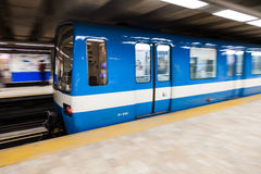 Montreal Metro Train with Motion Blur. Editorial - Montreal, Canada. Fast Matro Train with Motion Blur Passing at the Station During a winter day royalty free stock photo