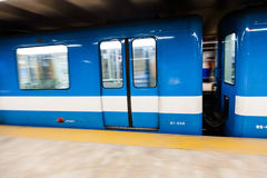 Montreal Metro Train with Motion Blur. Editorial - Montreal, Canada. Fast Matro Train with Motion Blur Passing at the Station During a winter day royalty free stock photos